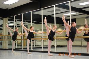 Dance Students stretching at the barre