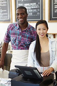 Small business owners at a cash register